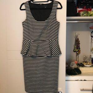 Black and white striped peplum dress